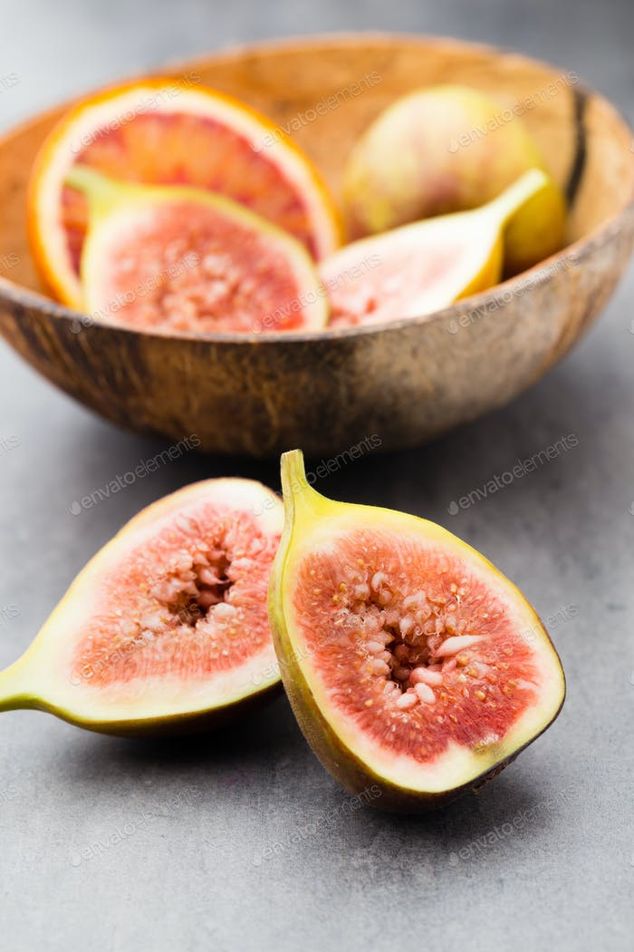 Bloody Sicilian oranges and figs. Shallow depth of field.