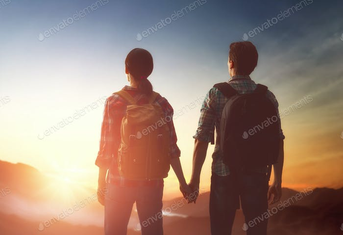 Couple looks at sunset