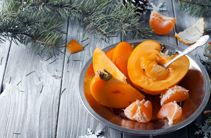fresh persimmon fruit and mandarin