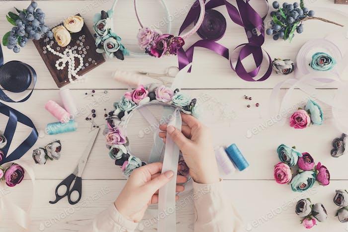 Master making handmade jewelry, top view