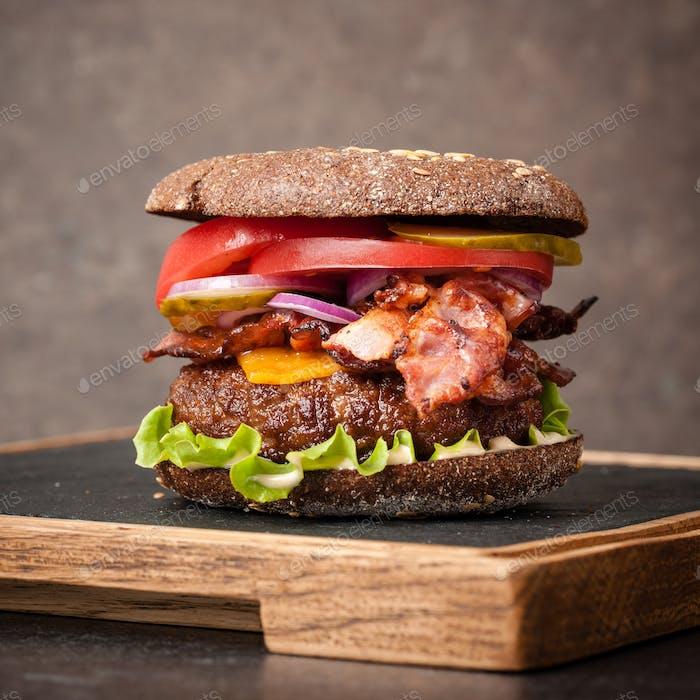 Burger on serving board