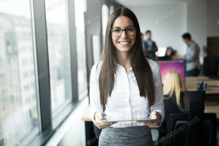 Portrait of happy smiling beautiful brunette businesswoman