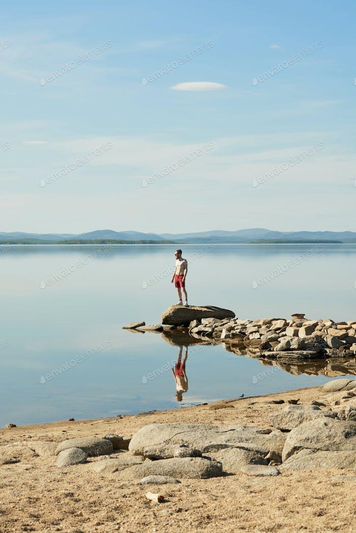 Man Enjoying Peaceful Lake