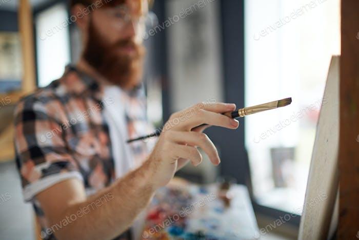 Man with paintbrush