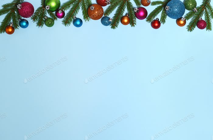 Christmas frame of fir branches and colored baubles