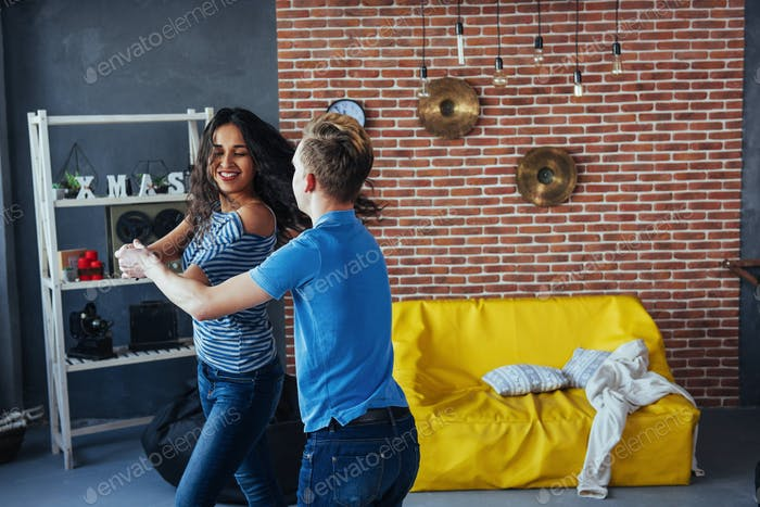 Young couple dancing latin music: Bachata, merengue, salsa