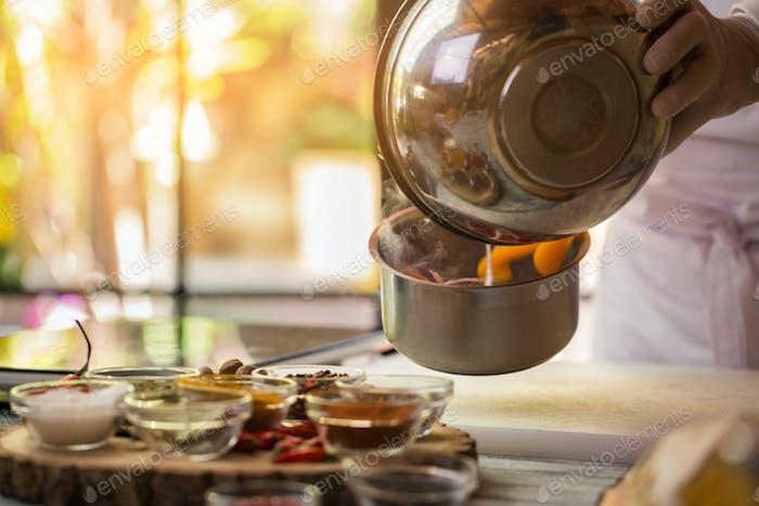 Liquid pours into saucepan