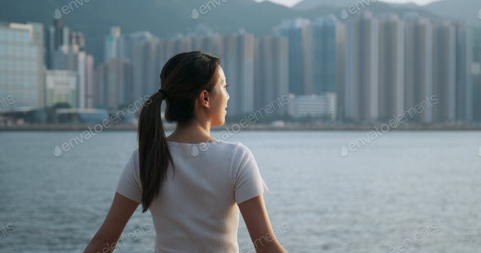 Woman look around the sea view in Hong Kong