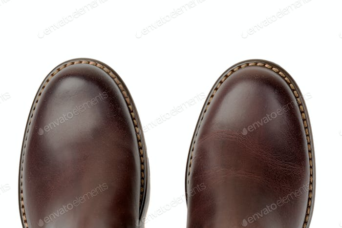 Brown leather shoes close-up, top view