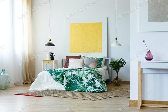 Spacious bedroom with artworks