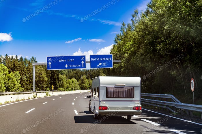 VR Caravan car travels on the highway.