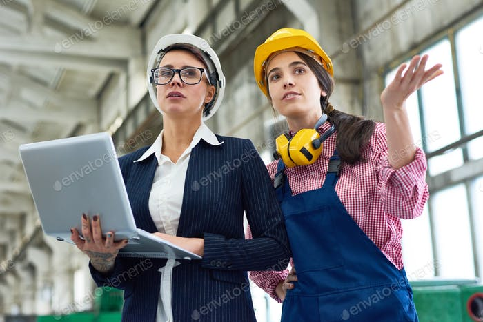Two Women at Manufacturing Plant