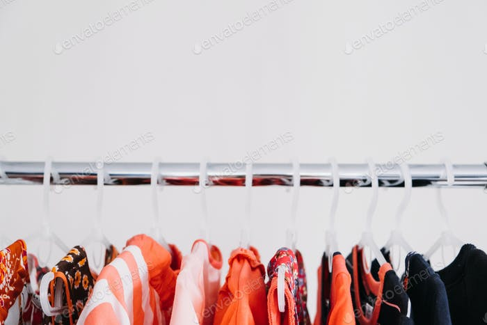 Circular Economy, Second hand, Fast fashion, Sustainable fashion. Many second hand red colors