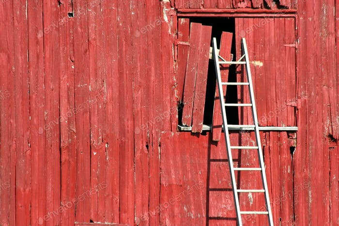 Ladder on a red barn
