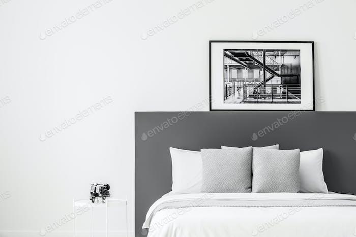 Poster in contrast bedroom interior