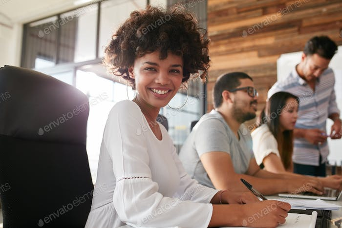 Attractive young woman sitting at conference room