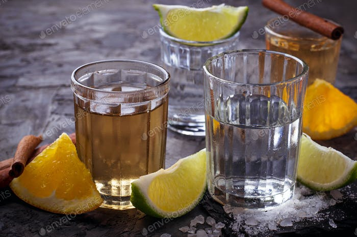 Shots of silver and gold tequila with lime, salt, orange and cinnamon