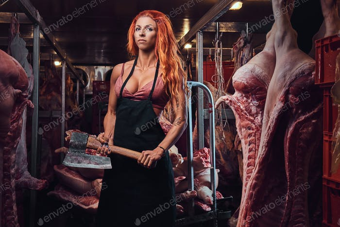 Redhead female in a meat factory.