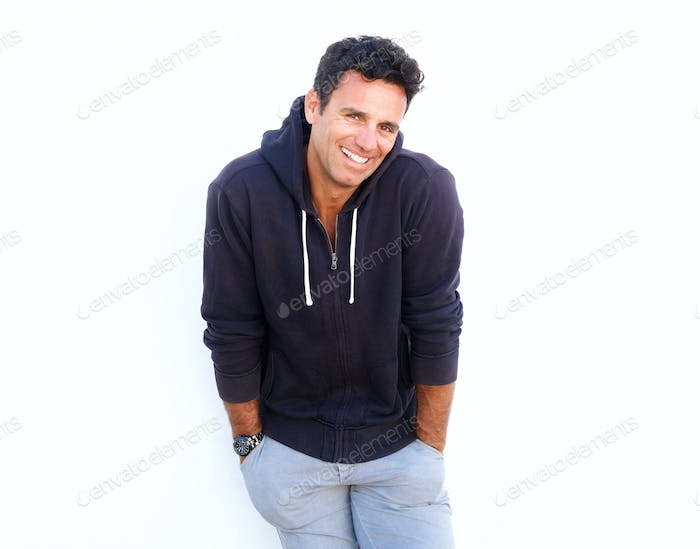 Handsome middle aged guy laughing against white background