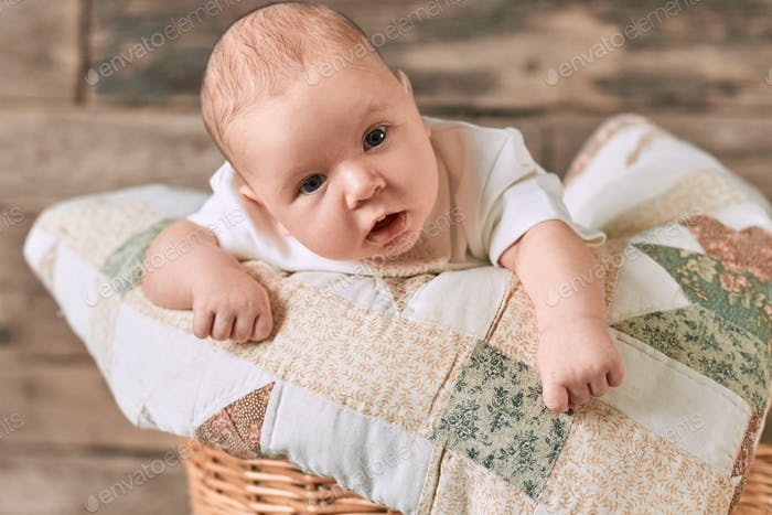Infant with surprised face