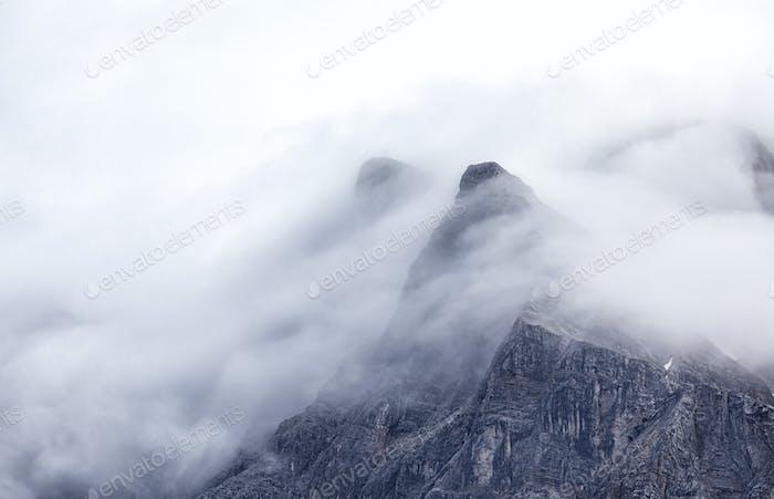 mountain Zugspitze peaks in fog