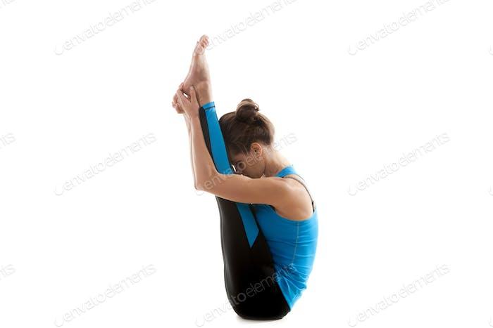 Sporty Yoga girl stretching