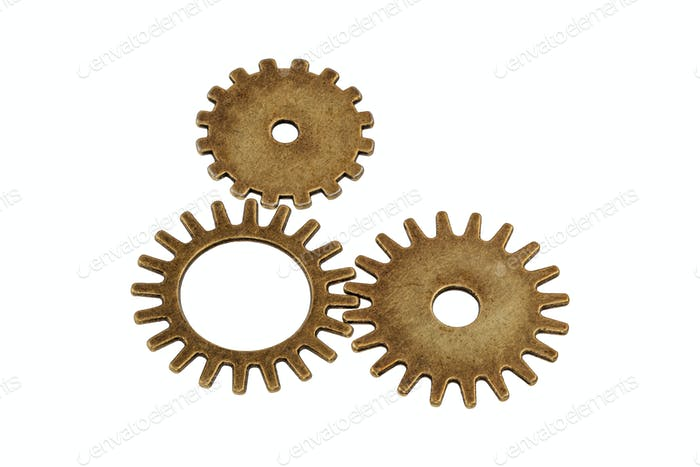 Brass gears on a white background