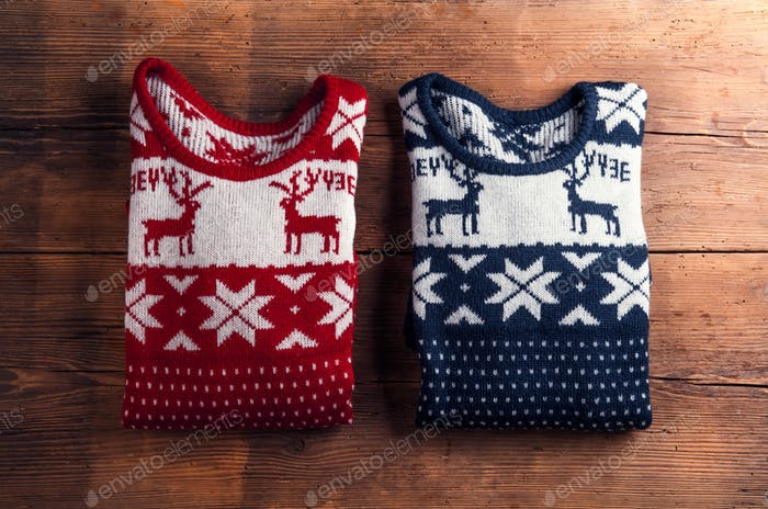 Two sweaters on a table