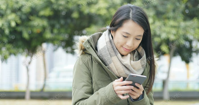 Woman reading message on cellphone