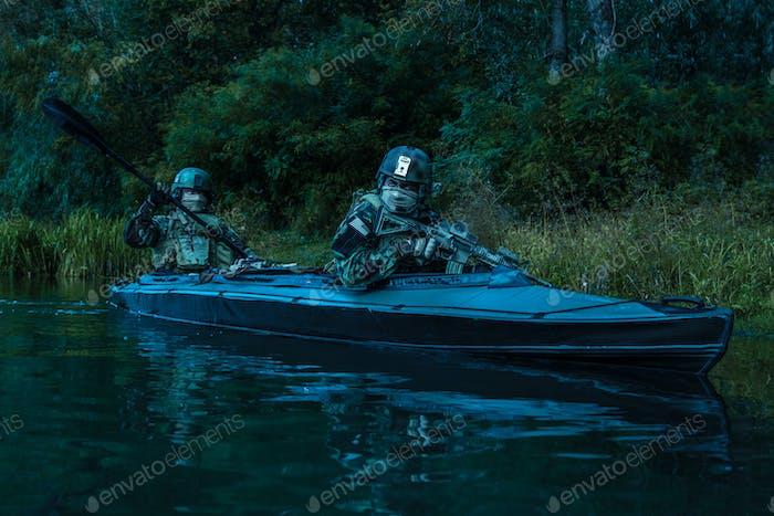 Militants in army kayak