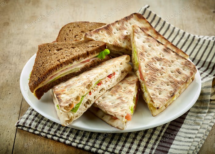 plate of various triangle sandwiches