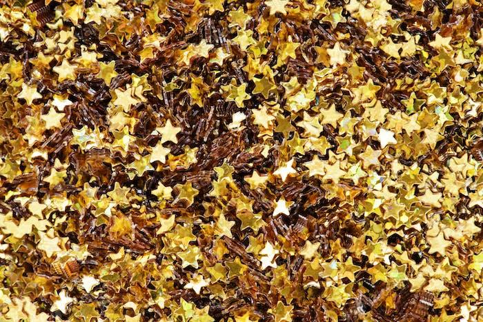 Closeup of golden stars decorative papers closeup