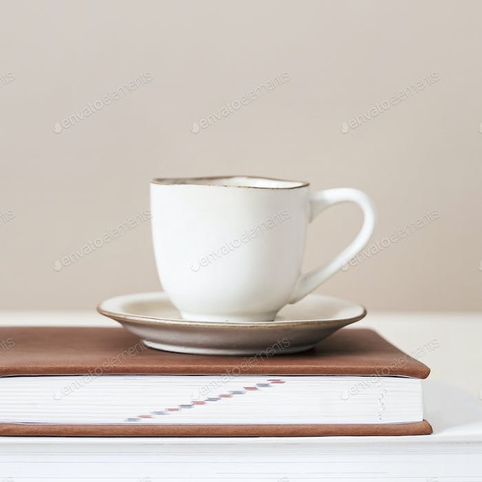 White tea cup on a book
