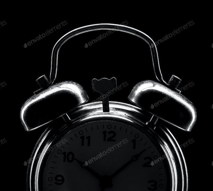 Silhouette of classical alarm clock