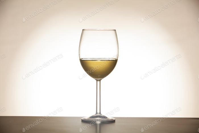Glass of wine on gradient background