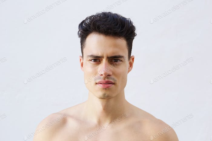 Close up portrait of a handsome young shirtless man