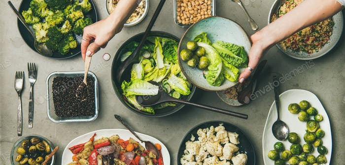 Healthy vegan dishes and woman hands with plate, wide composition