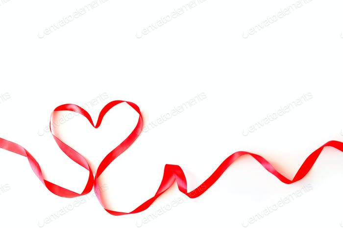 Heart made of red silk ribbon isolated on a white background. Valentine's Day Concept, February 14th