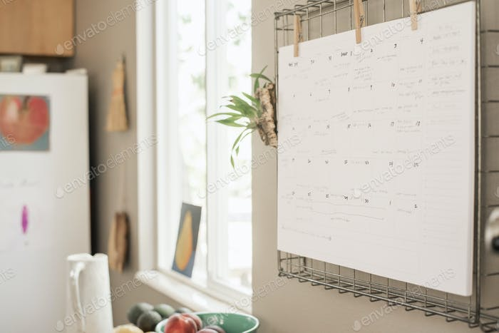 Wall planner on a kitchen wall.