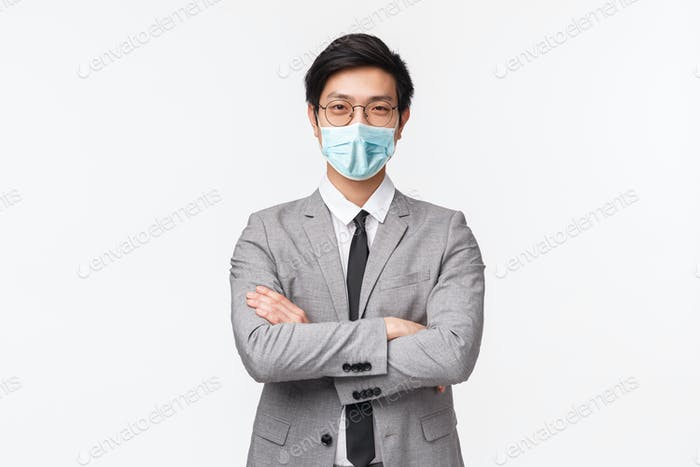 Waist-up portrait of confident smart and talented asian businessman, successful employer in grey