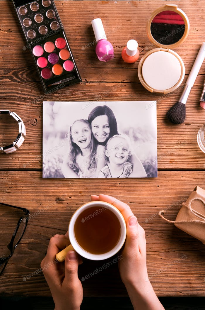 Mothers day composition. Photo, coffee and make up products