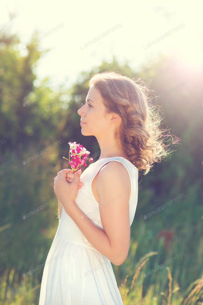 Beautiful woman with flowers.