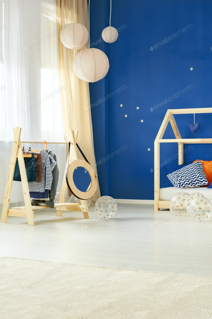 Room with kids clothes rack