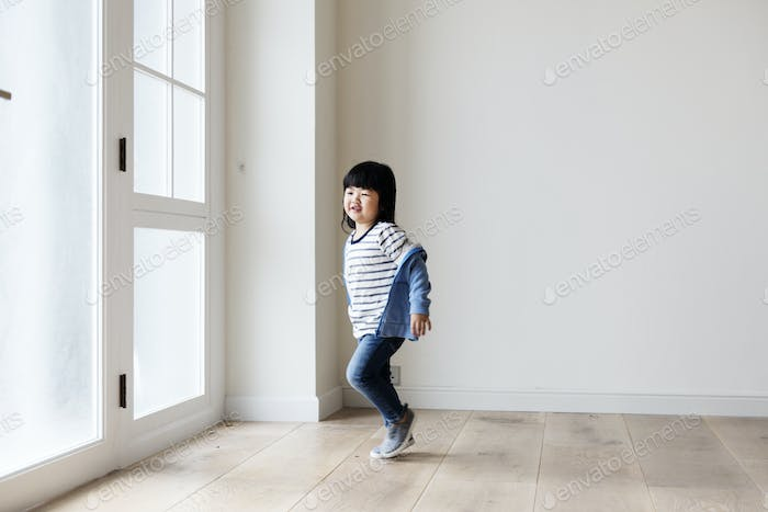 A cheerful Asian girl in new house