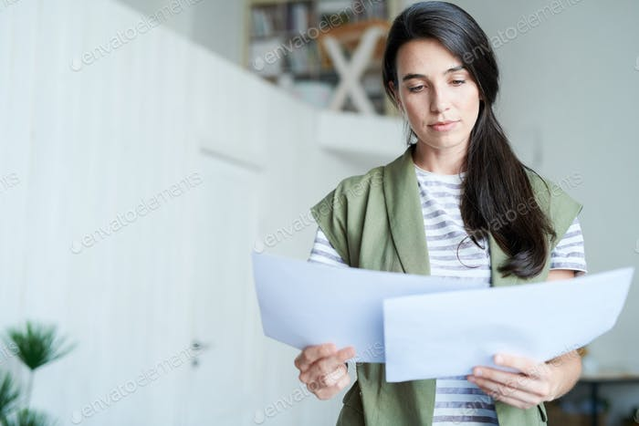 Woman Reading Documents