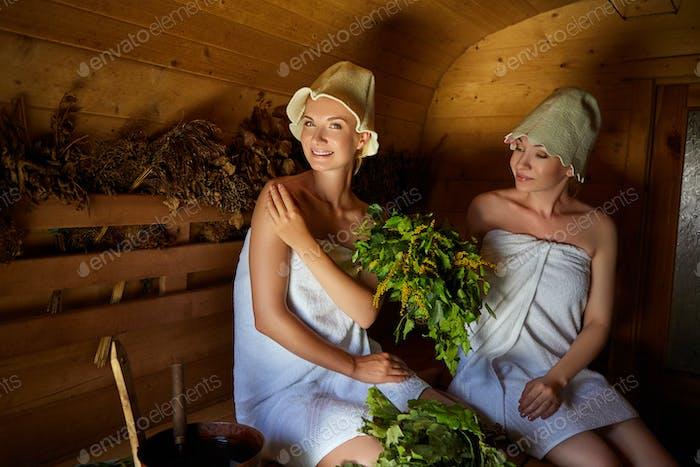 two girls relaxing in sauna