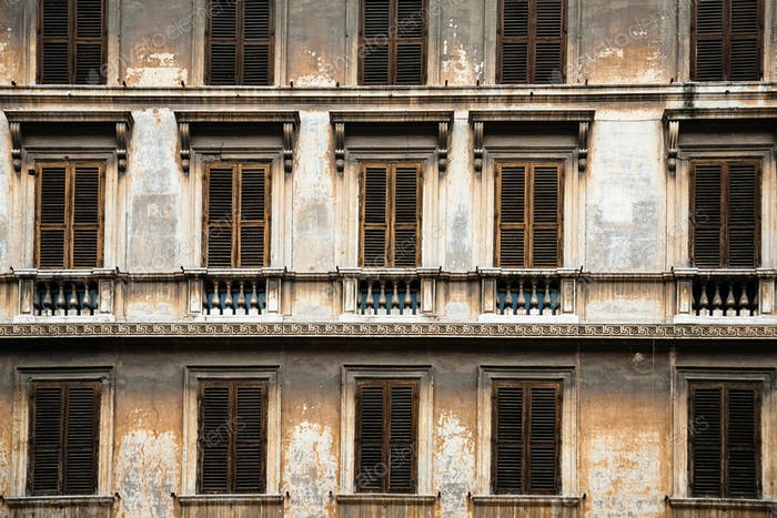 facade of old urban house in Rome city