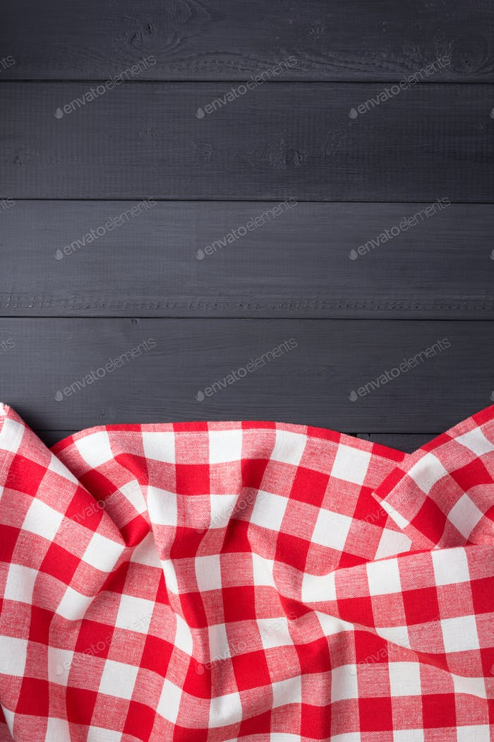 cloth napkin or  tablecloth checked at wooden plank board table