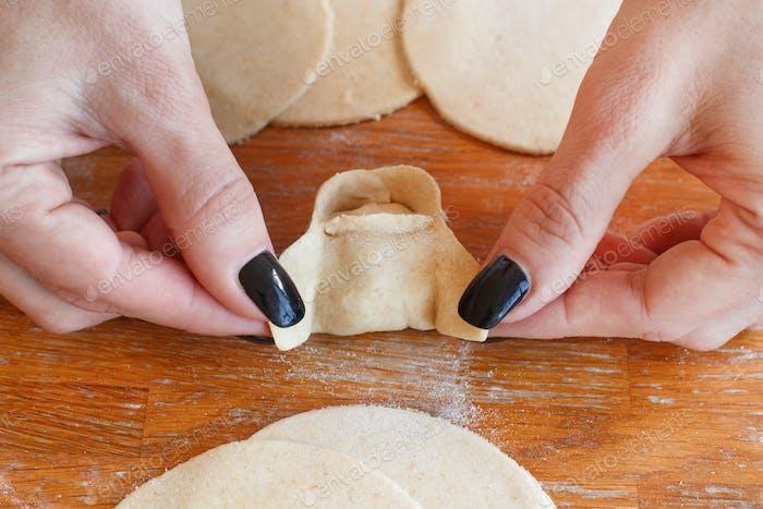 Making dumplings manti