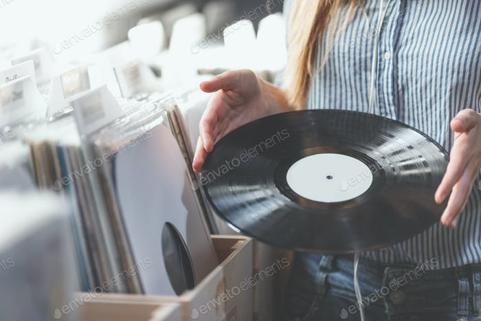 Young woman with music records indoors